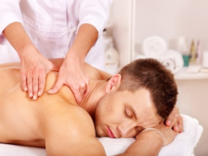 guy lying on table getting a mobile deep tissue massage